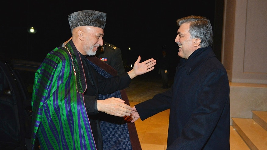 In this photo taken late Wednesday, Feb. 12, 2014 and released by the Turkish Presidency Press Office, Turkish President Abdullah Gul, right, greets his Afghan counterpart Hamid Karzai in Ankara, Turkey. Karzai and Pakistani Prime Minister Nawaz Sharif are in Turkey for the 8th Afghanistan-Pakistan-Turkey Trilateral Summit. (AP Photo/Mustafa Oztartan, Turkish Presidency Press Office)