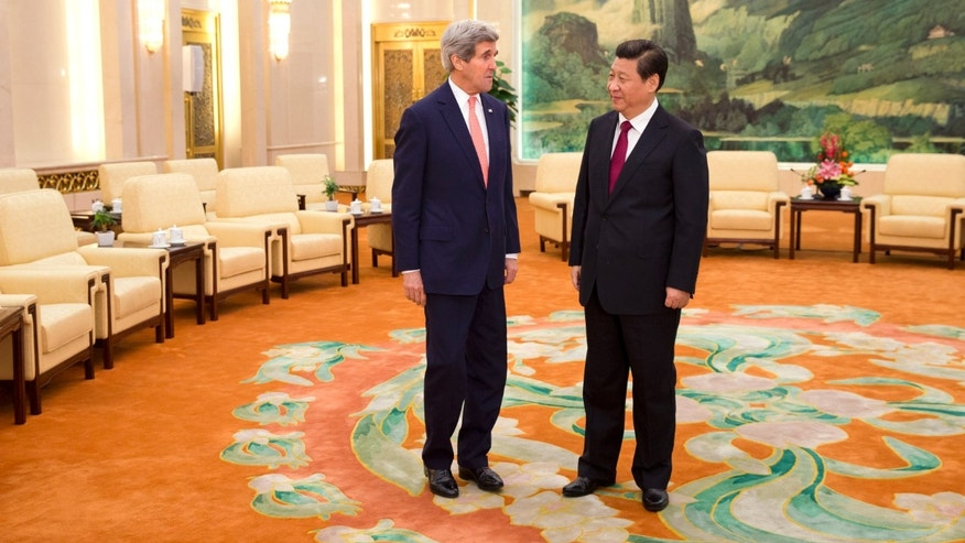 U.S. Secretary of State John Kerry, left, meets with Chinese President Xi Jinping at the Great Hall of the People in Beijing, China Friday, Feb. 14, 2014. Kerry is meeting senior Chinese officials on Friday in Beijing to seek their help in bringing a belligerent North Korea back to nuclear disarmament talks. (AP Photo/Evan Vucci, Pool)