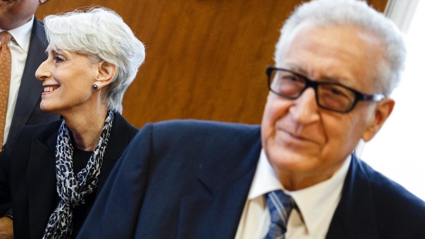 United States Under Secretary of State for Political Affairs Wendy Sherman, left, and UN-Arab League envoy for Syria Lakhdar Brahimi, right, arrive for a trilateral meeting with Russian Deputy Minister of Foreign Affairs Gennady Gatilov   during the second round of negotiations between the Syrian government and the opposition at the European headquarters of the United Nations, in Geneva, Switzerland, Thursday, Feb. 13, 2014.  (AP Photo/Valentin Flauraud,Pool)