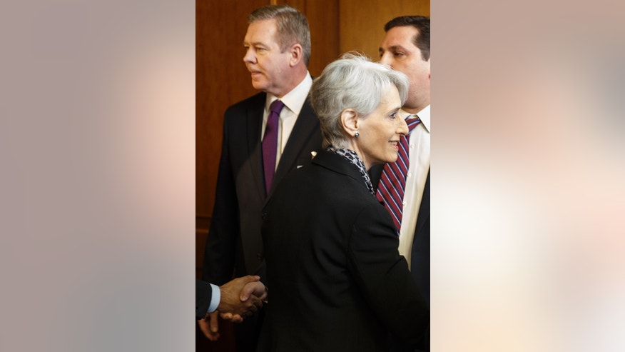 United States Under Secretary of State for Political Affairs Wendy Sherman, right, passes in front of Russian Deputy Minister of Foreign Affairs Gennady Gatilov, left,  as they arrive for a trilateral meeting with UN-Arab League envoy for Syria Lakhdar Brahimi  during the second round of negotiations between the Syrian government and the opposition at the European headquarters of the United Nations, in Geneva, Switzerland, Thursday, Feb. 13, 2014.  (AP Photo/Valentin Flauraud,Pool)