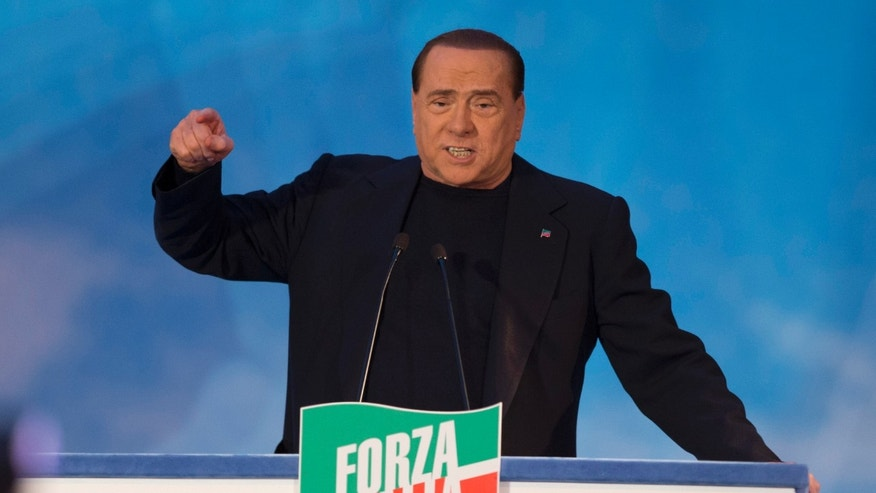 FILE -- In this Nov. 27, 2013 photo, Silvio Berlusconi gestures as he addresses supporters in Rome. He has been convicted of tax fraud, booted out of the Senate and banned from political office. In any other country, that would be three strikes. But in Italy, Silvio Berlusconi has not lost his political legitimacy, and it will be on full display when he leads his Forza Italia party to meet with Italy's president to discuss prospects for a new government after Premier Enrico Letta's resignation Friday. Berlusconi's reemergence on Italy's political scene comes just days after a court in Naples put him on trial yet again, this time for allegedly paying a senator 3 million euros ($4 million) to switch parties to bring down a rival government. (AP Photo/Andrew Medichini)