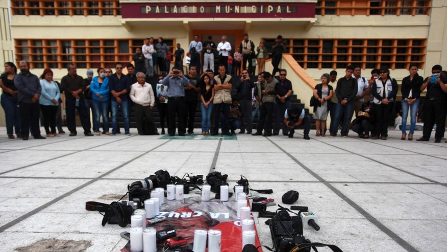 Local journalists stage a protest on the day that fellow journalist Gregorio Jimenez was buried after his body was discovered alongside the corpse of a union leader whose kidnapping was the topic of two of Jimenez's stories, in Coatzacoalcos, Mexico, Wednesday, Feb. 12, 2014. Veracruz state officials concluded that Jimenez, a police beat reporter, was killed in a personal vendetta, unrelated to his reporting. But journalists throughout Mexico are calling for a thorough investigation. Jimenez is the 12th journalist slain or gone missing since 2010 in the Gulf state of Veracruz. (AP Photo/Felix Marquez)