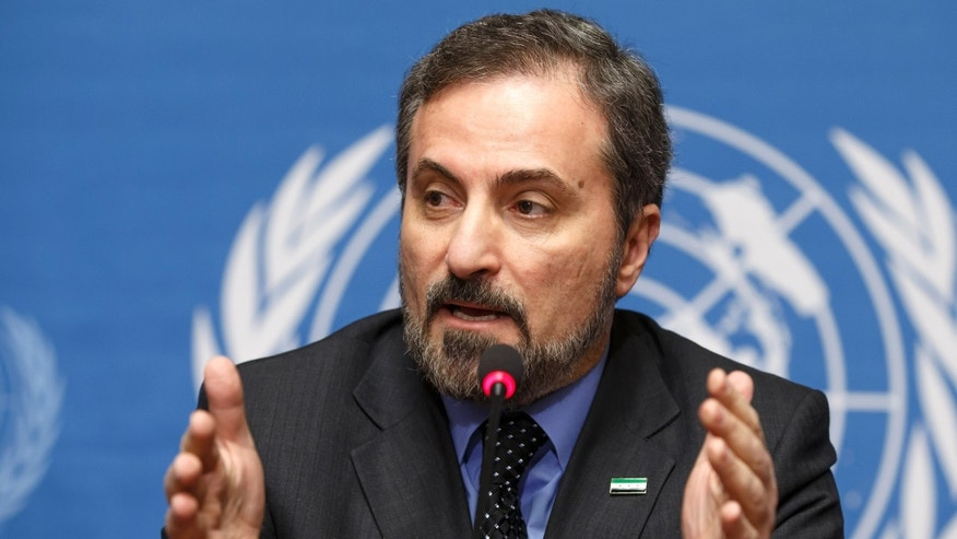 Louay Safi, spokesperson for the Syrian National Coalition, speaks to the media during a news conference after the second round of negotiations between the Syrian government and the opposition at the European headquarters of the United Nations, in Geneva, Switzerland, Friday, Feb. 14, 2014. (AP Photo/Keystone, Salvatore Di Nolfi)