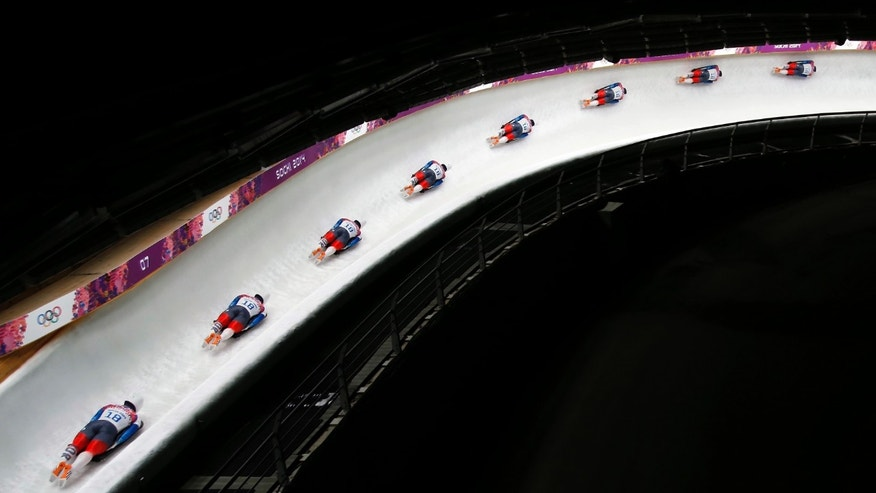 In this image made with a multiple exposure, Yun Sung-bin of South Korea speeds down the track during the men's skeleton final competition at the 2014 Winter Olympics, Saturday, Feb. 15, 2014, in Krasnaya Polyana, Russia.  (AP Photo/Felipe Dana)