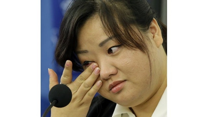 FILE - This Oct. 30, 2013 file photo shows Jin hye Jo wiping a tear as she testifies during a hearing of the United Nations mandated Commission of Inquiry about the human rights situation in the Democratic People's Republic of Korea, in Washington. Her father was tortured in detention in North Korea and died. Her elder sister went searching for food during the great famine of the 1990s, only to be trafficked to China. Her two younger brothers died of starvation, one of them a baby without milk whose life ebbed away in her arms (AP)