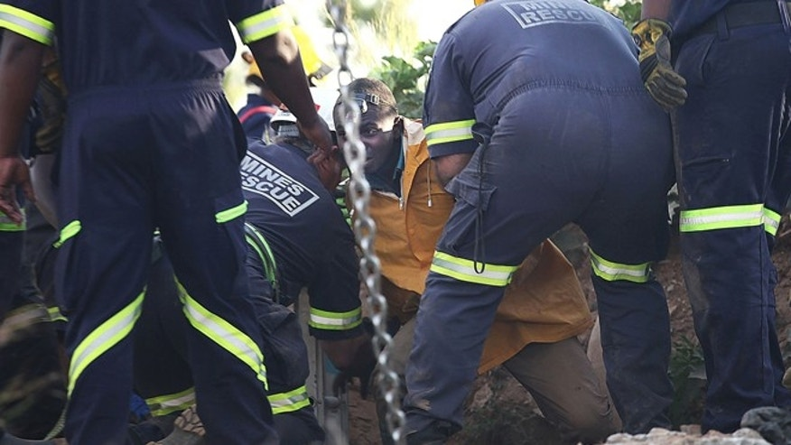 Feb. 16, 2014: A trapped illegal miner is bought to the surface at a disused gold mine shaft near, Benoni, South Africa.