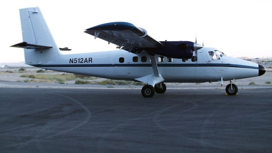FILE - This Aug. 10, 2007 file photo provided by NOAA shows a DeHavilland DHC6 Twin Otter similar to the one belonging to Nepal Airlines that was missing in Nepal's mountainous west Sunday, Feb. 16, 2014. (AP)