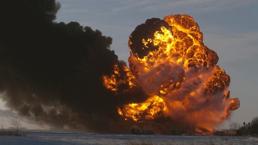 "Dec. 30, 2013: In this file photo, a fireball goes up at the site of an oil train derailment in Casselton, N.D. Warning that a ""major loss of life"" could result from an accident involving the increasing use of trains to transport large amounts of crude oil, U.S. and Canadian accident investigators urged their governments to take a series of safety measures."