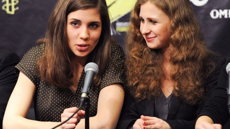 "FILE - In this Feb. 5, 2014 file photo, Nadezhda ""Nadya"" Tolokonnikova, left, and Maria ""Masha"" Alekhina of Pussy Riot, participate in a press conference for Amnesty International's ""Bringing Human Rights Home"" concert at the Barclays Center in New York. (AP)"