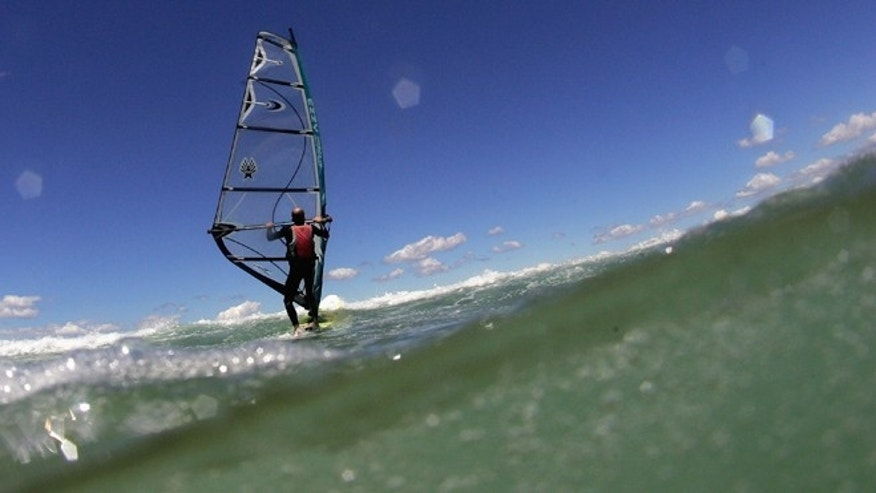 "GERROA, AUSTRALIA - NOVEMBER 22:  A competitor shows his skills during the Expression Session portion of the NSW Wavesailing Series event ""WindSurfNSnow Goin' Off"" at Seven Mile Beach on November 22, 2008 in Gerroa, Australia.  (Photo by Ezra Shaw/Getty Images)"