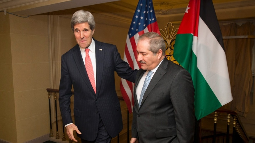 US Secretary of State John Kerry, left, meets with Jordanian Foreign Minister Nasser Judeh about the ongoing humanitarian crisis and violence in Syria on Wednesday, Feb. 19, 2014, in Paris. (AP Photo/ Evan Vucci)