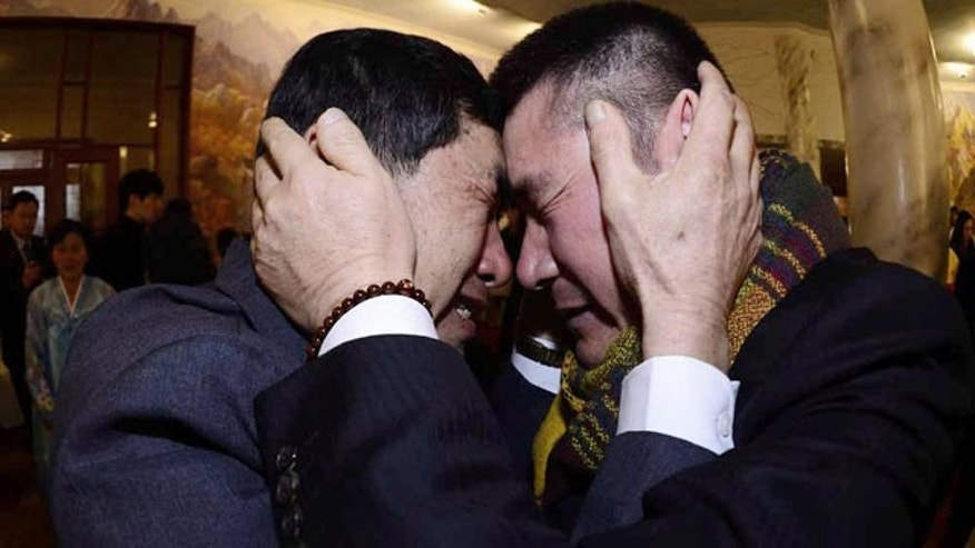 February 20, 2014: South Korean Park Yang-gon, left, and his North Korean brother Park Yang Soo get emotional as they met during the Separated Family Reunion Meeting at Diamond Mountain resort in North Korea.