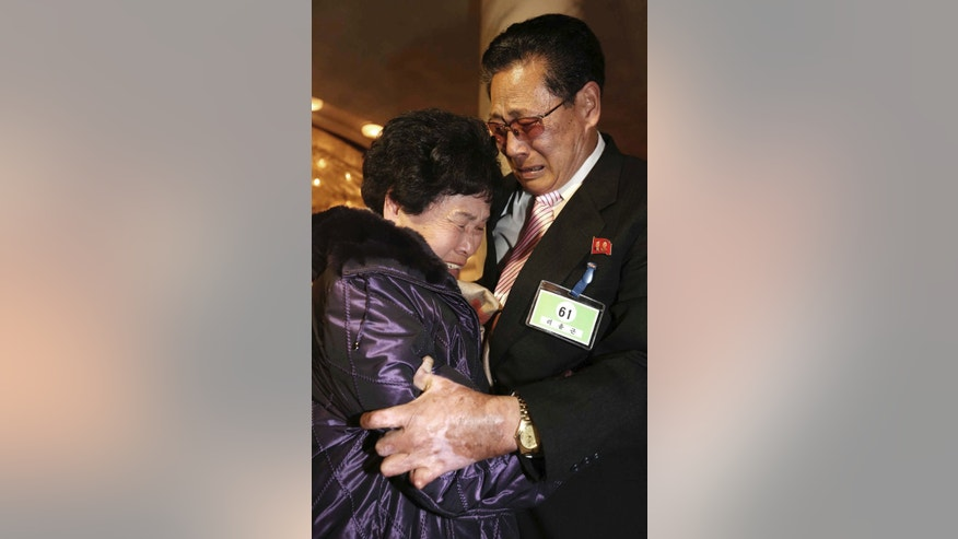 South Korean Lee Son-hyang, 88, left, and her North Korean brother Lee Yoon Geun ,72, get emotional as they reunite during the Separated Family Reunion Meeting at Diamond Mountain resort in North Korea, Thursday, Feb. 20, 2014. The rival nations struck a deal last week to go ahead with brief meetings of war-divided families, though there's wariness in Seoul that Pyongyang could back out again. As they waited anxiously in the days leading up to the trip, many elderly Koreans had been unsure whether they would be able to see their long-lost relatives' faces before they die. (AP Photo/Yonhap, Lee Ji-eun)  KOREA OUT
