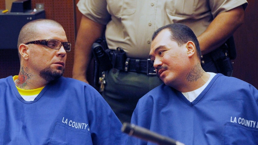Defendants Marvin Norwood, left, and Louie Sanchez appear during a hearing Thursday Feb. 20, 2014 in Los Angeles. The two men pleaded guilty Thursday to a 2011 beating at Dodger Stadium that left San Francisco Giants fan Bryan Stow brain damaged and disabled. They were immediately sentenced by an angry judge who called them cowards and the sort of people that sports fans fear when they go to games.(AP)