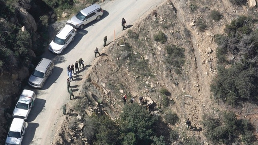 This aerial photo shows the scene of a shooting by a U.S. Border Patrol agent near San Diego on Tuesday, Feb. 18, 2014.  Investigators say a man who was shot and killed by a U.S. Border Patrol agent near San Diego threw several large rocks at the agent, including one the size of a basketball. The San Diego County Sheriff's Department said Wednesday that the attacker began throwing fist-sized rocks at the agent from a hillside perch. The rocks got larger, and one of the bigger pieces hit the agent in the head. The sheriff's department says the agent fired his gun twice Tuesday, fearing that he might be killed or incapacitated if he was hit again. The agent was treated for minor injuries at a hospital and released.  (AP Photo/U-T San Diego, John Gibbins)  NO SALES; COMMERCIAL INTERNET OUT