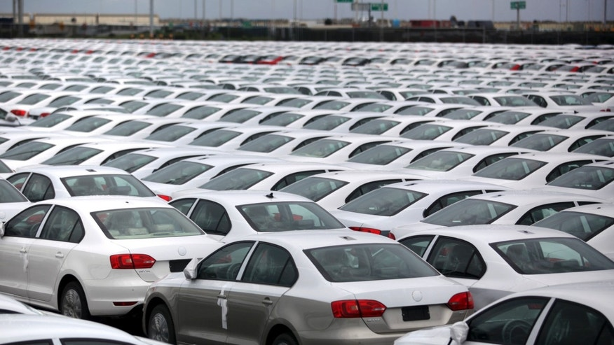 FILE - In this Sept. 19, 2013 file photo, Volkswagen Jettas produced in Mexico for export are parked at the port terminal in the Gulf city of Veracruz, Mexico. Mexico is on track to replace Japan as the second-largest exporter of cars to the United States by the end of 2014, and is expected to surpass Canada for the top spot by the end of 2015. (AP Photo/Felix Marquez, File)