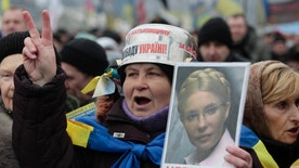 Feb. 9, 2014 - FILE photo of opposition supporter holding a portrait of former prime minister Yulia Tymoshenko during a rally in Independence Square in Kiev, Ukraine.