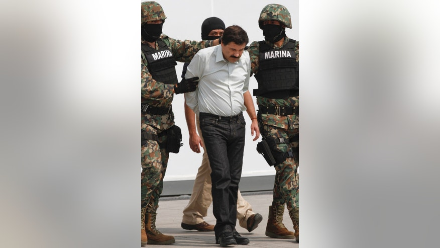 "Joaquin ""El Chapo"" Guzman is escorted to a helicopter in handcuffs by Mexican navy marines at a navy hanger in Mexico City, Saturday, Feb. 22, 2014. A senior U.S. law enforcement official said Saturday, that Guzman, the head of Mexicoís Sinaloa Cartel, was captured alive overnight in the beach resort town of Mazatlan. Guzman faces multiple federal drug trafficking indictments in the U.S. and is on the Drug Enforcement Administrationís most-wanted list. (AP Photo/Marco Ugarte)"