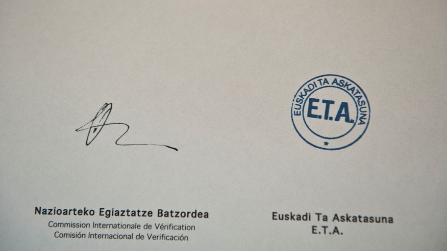 In this photo of a document, the Basque armed group ETA announced a first step in a disarmament process, putting some weapons and explosives out of use, in Bilbao northern Spain, Friday, Feb. 21, 2014. ETA is blamed for killing some 830 people between the late 1960s in bombings and its 2011 cease-fire in a campaign for a Basque homeland in northern Spain and southwest France. (AP Photo/Alvaro Barrientos)