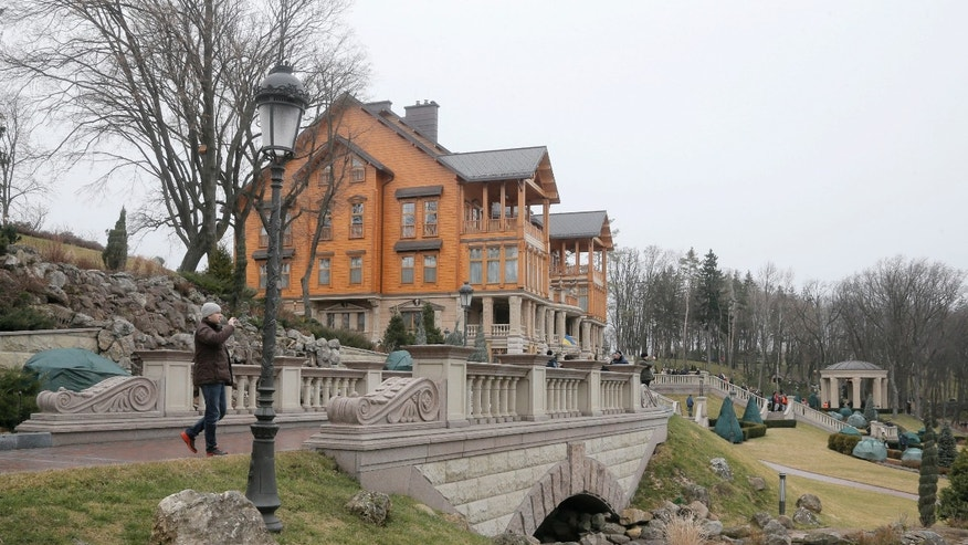 Feb, 22, 2014: A man take a photo in the grounds of former Ukrainian President Yanukovych's country residence in Mezhyhirya, Kiev region, Ukraine.