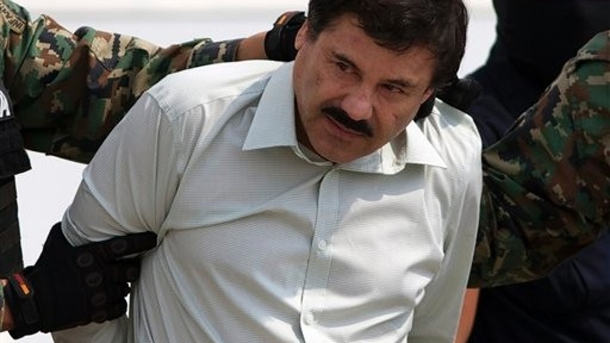 "Joaquin ""El Chapo"" Guzman is escorted to a helicopter in handcuffs by Mexican navy marines at a navy hanger in Mexico City, Saturday, Feb. 22, 2014. A senior U.S. law enforcement official said Saturday, that Guzman, the head of Mexicoís Sinaloa Cartel, was captured alive overnight in the beach resort town of Mazatlan. Guzman faces multiple federal drug trafficking indictments in the U.S. and is on the Drug Enforcement Administrationís most-wanted list. (AP Photo/Eduardo Verdugo)"
