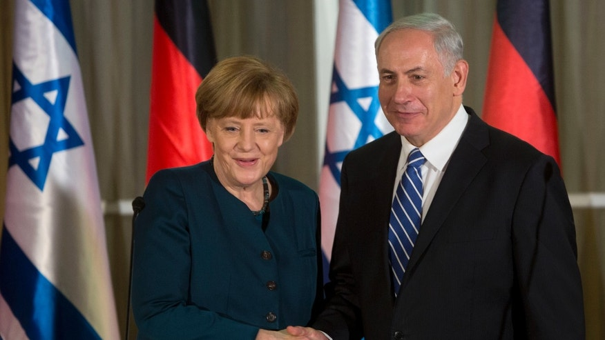 Germany's Chancellor Angela Merkel, left, shakes hands with Israeli Prime Minister Benjamin Netanyahu during their meeting at the Prime minister's residence in Jerusalem, Monday, Feb. 24, 2014. (AP Photo/Sebastian Scheiner)