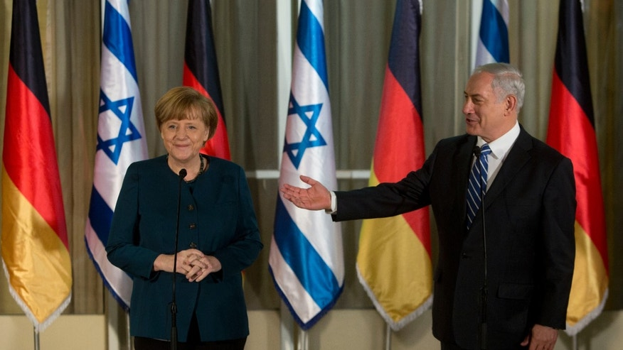 Germany's Chancellor Angela Merkel, left, looks on as Israeli Prime Minister Benjamin Netanyahu gestures during their meeting at the Prime minister's residence in Jerusalem, Monday, Feb. 24, 2014. (AP Photo/Sebastian Scheiner)
