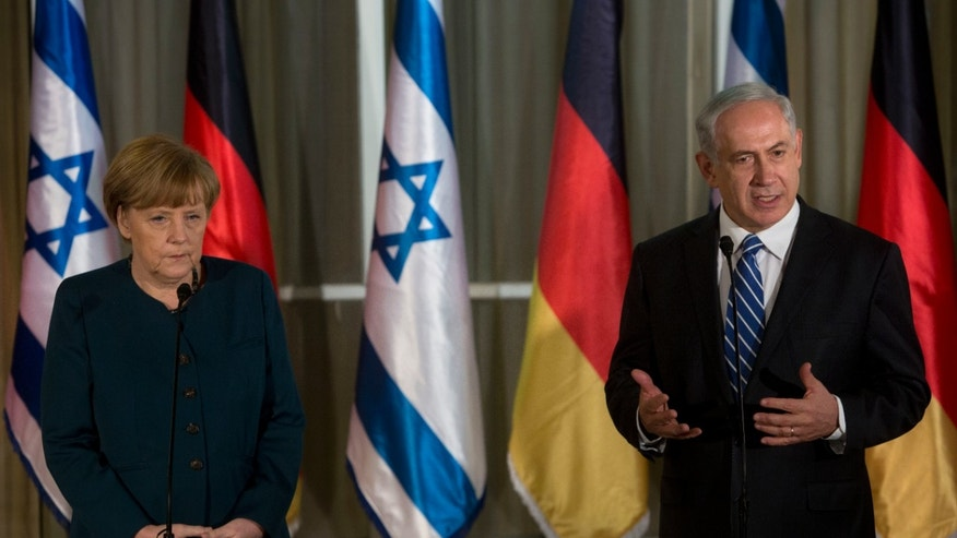 Germany's Chancellor Angela Merkel, left, looks on as Israeli Prime Minister Benjamin Netanyahu gestures as he speaks during their meeting at the Prime minister's residence in Jerusalem, Monday, Feb. 24, 2014. (AP Photo/Sebastian Scheiner)