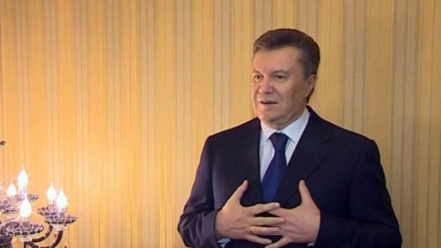 In this image made from video released by the Regional Administration of Kharkiv and distributed by AP Video, Viktor Yanukovych, President of Ukraine,  speaks in Kharkiv, Ukraine, Saturday, Feb. 22, 2014. Protesters took control of Ukraine's capital Saturday, seizing the president's office as parliament voted to remove him and hold new elections.  Yanukovych described the events as a coup and insisted he would not step down. After a tumultuous week that left scores dead and Ukraine's political destiny in flux, fears mounted that the country could split in two — a Europe-leaning west and a Russian-leaning east and south.  (AP Photo / Regional Administration of Kharkiv)