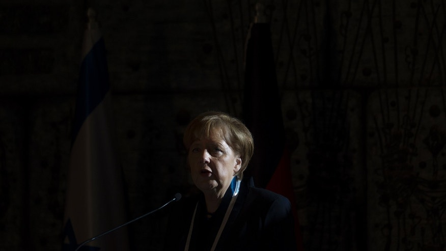 German Chancellor Angela Merkel speaks after she received the Presidential Medal of Distinction during a ceremony at the President's residence in Jerusalem,Tuesday, Feb. 25, 2014.The Presidential Medal is the highest civil medal given by the State of Israel. (AP Photo/Ariel Schalit)