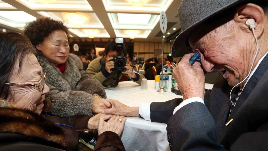 South Korean Lee Oh-soon, 94, left, weeps with her North Korean brother Jo Won Je, 83, after the Separated Family Reunion Meeting at Diamond Mountain in North Korea, Tuesday, Feb. 25, 2014. The first reunions of North and South Koreans in more than three years have been held in North Korea. The final group of Koreans to participate in reunions ends Tuesday. (AP Photo/Yonhap, Lee Ji-eun)  KOREA OUT