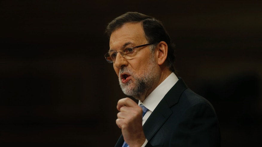 Spain's Prime Minister Mariano Rajoy speaks during a state of the nation debate at the Spanish Parliament in Madrid, Spain, Tuesday, Feb. 25, 2014. Prime Minister Mariano Rajoy has revised Spain's economy growth for 2014 upward to 1 percent and announced tax reduction reforms and job creation incentives to give the country a boost after punishing years of recession. Spain's economy began to crumble in 2008 with the collapse of its bloated real-estate sector. It emerged from a two-year recession late last year. (AP Photo/Andres Kudacki)