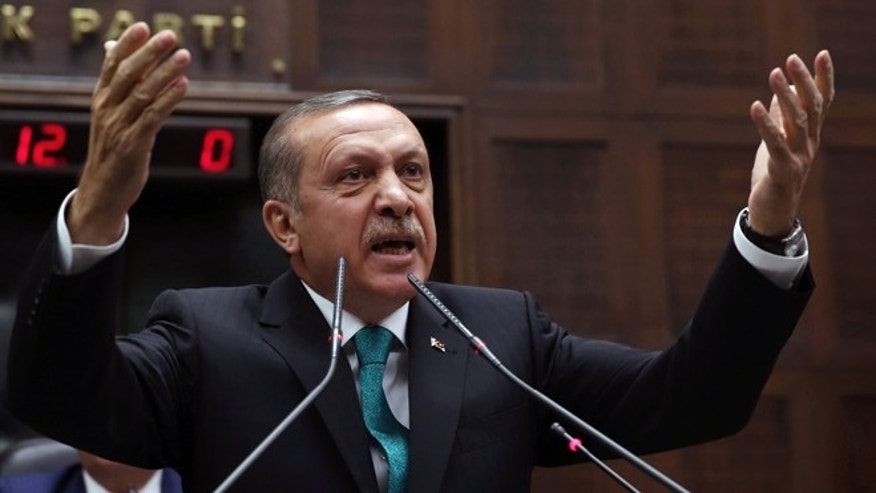 Jan. 14, 2014: In this file photo, Turkey's Prime Minister Recep Tayyip Erdogan addresses his supporters at the parliament in Ankara, Turkey.