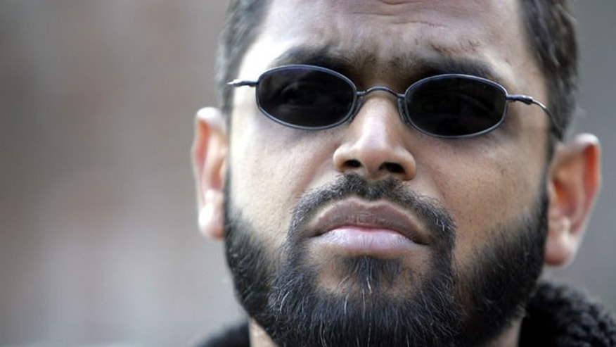 FILE - March 3, 2006: Moazzam Begg outside the United States Embassy in London. British police say Begg is one of four people arrested on suspicion of Syria-related terrorism offenses in the Birmingham area of central England. Police say 45-year-old Begg is suspected of attending a terrorist training camp and facilitating terrorism overseas. (AP Photo/Alastair Grant, File)