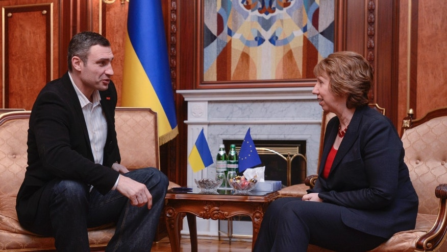 Ukrainian lawmaker and chairman of the Ukrainian opposition party Udar (Punch), former WBC heavyweight boxing champion Vitali Klitschko, left, speaks to EU foreign policy chief Catherine Ashton during their meeting in Kiev, Ukraine, Monday, Feb. 24, 2014.The head of OSCE, the European security organization is proposing the establishment of an international contact group to support Ukraine in its difficult transition period.(AP Photo/Andrew Kravchenko, pool)