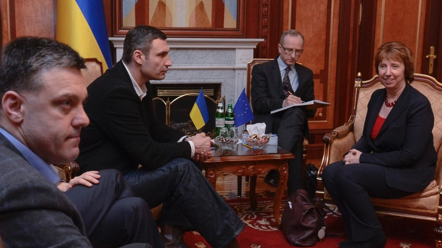 Ukrainian opposition leader Oleg Tjagnibok, left, and Ukrainian lawmaker and chairman of the Ukrainian opposition party Udar (Punch), former WBC heavyweight boxing champion Vitali Klitschko, second left, during their talks with EU foreign policy chief Catherine Ashton, foreground right, during their talks in Kiev, Ukraine, Monday, Feb. 24, 2014. The head of  OSCE, the European security organization is proposing the establishment of an international contact group to support Ukraine in its difficult transition period.(AP Photo/Andrew Kravchenko, Pool)