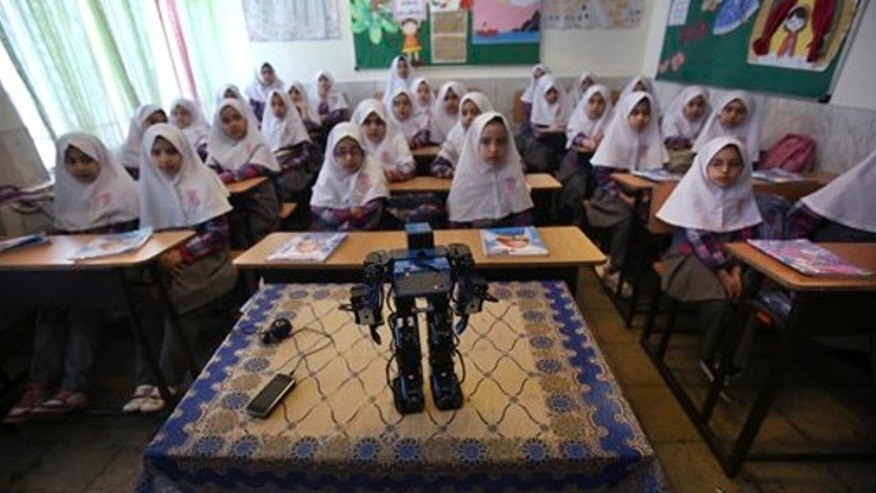 Feb. 24, 2014: Veldan, a humanoid praying robot which is built by Iranian schoolteacher Akbar Rezaie, performs morning prayer in front of Alborz elementary school girls in the city of Varamin some 21 miles south of the capital Tehran, Iran.