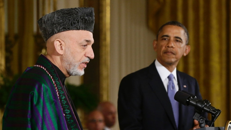 FILE - This Jan. 11, 2013 file photo shows President Barack Obama listening as Afghan President Hamid Karzai speaks during a news conference in the East Room at the White House in Washington. President Barack Obama has ordered the Pentagon to plan for a full American withdrawal from Afghanistan by the end of this year should the Afghan government refuse to sign a security agreement with the US the White House said Tuesday. (AP Photo/Charles Dharapak, File)