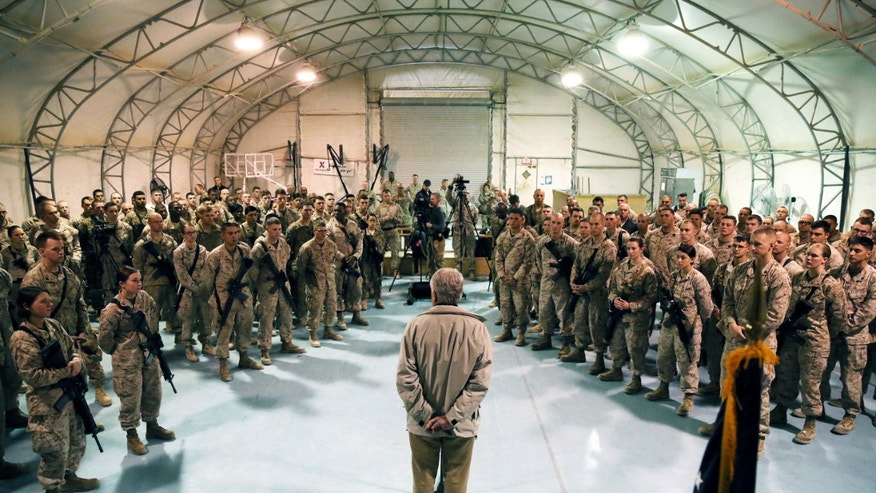 FILE - In this Dec. 8, 2013 pool-file photo, Defense Secretary Chuck Hagel speaks with U.S. troops at Camp Bastion, Afghanistan. President Barack Obama has ordered the Pentagon to plan for a full American withdrawal from Afghanistan by the end of this year should the Afghan government refuse to sign a security agreement with the US the White House said Tuesday. (AP Photo/Mark Wilson, Pool-File)