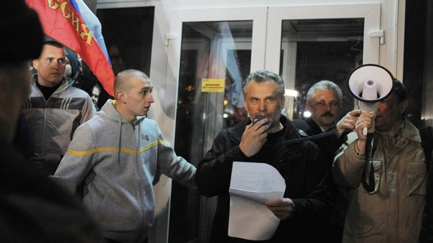 Feb. 25, 2014: New mayor of the city of Sevastopol Alexey Chaly, center, speaks to a crowd during a rally in Sevastopol, Ukraine. After the head of the Sevastopol City Council stepped down, a rally in Sevastopol named local businessman and Russian citizen Alexei Chalyi as the new city mayor, but he has also kept a low profile. A Russian flag was flying in front of the city council building in Sevastopol, a key port in Crimea, a pro-Russian region in Ukraine nearly surrounded by the Black Sea. Protesters had torn down the Ukrainian flag a few days ago, pleading with Moscow to protect them from the new authorities in Ukraine.