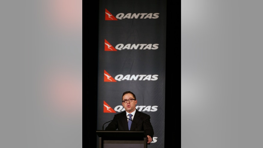 Qantas chief executive Alan Joyce announces a first-half loss of 235 million Australian dollars ($211 million) during a press conference in Sydney, Thursday, Feb. 27, 2014. The Australian flag carrier said the 5,000 jobs would be cut as part of its bid to cut AU$2 billion in costs over three years. (AP Photo/Rick Rycroft)