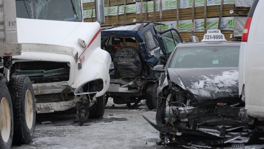 Vehicles are damaged after a multi-vehicle pileup on Highway 400 near Innisfil, Ontario, Canada, Thursday, Feb. 27, 2014. Provincial police say a massive multi-vehicle pileup has closed Highway 400 and it will likely remain closed for much of the day. Police say as many as 96 vehicles were involved in the series of collisions early in the morning. No major injuries have been reported. (AP Photo/The Canadian Press, Barrie Advance, Rick Vanderlinde)