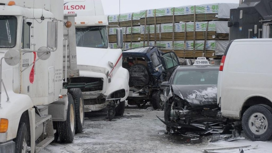 Vehicles are damaged after a multi-vehicle pileup on Highway 400 near Innisfil, Ontario, Canada, Thursday, Feb. 27, 2014.  Provincial police say a massive multi-vehicle pileup has closed Highway 400 in Innisfil, south of Barrie, and it will likely remain closed for much of the day. Police say as many as 96 vehicles were involved in the series of collisions early in the morning.     No major injuries have been reported. (AP Photo/The Canadian Press, Barrie Advance-Rick Vanderlinde)