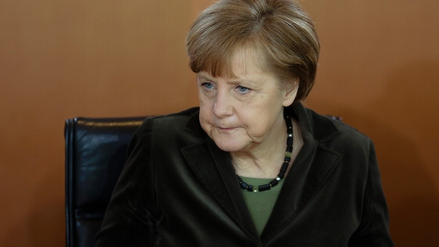 German Chancellor Angela Merkel attends the weekly cabinet meeting at the chancellery in Berlin, Germany, Wednesday, Feb. 26, 2014.  (AP Photo/Markus Schreiber)