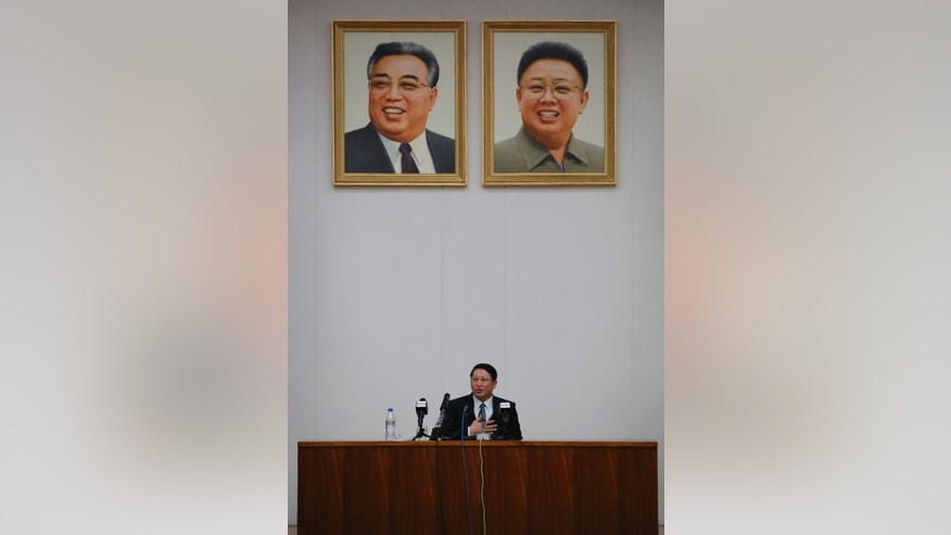 Kim Jung Wook, a South Korean Baptist missionary speaks under the portrait of late leaders Kim Il Sung and Kim Jong Il during a news conference in Pyongyang, North Korea, Thursday, Feb. 27, 2014. Kim who was arrested more than four months ago for allegedly trying to establish underground Christian churches in North Korea told reporters Thursday he is sorry for his ``anti-state'' crimes and appealed to North Korean authorities to show him mercy by releasing him from their custody. (AP Photo/Vincent Yu)