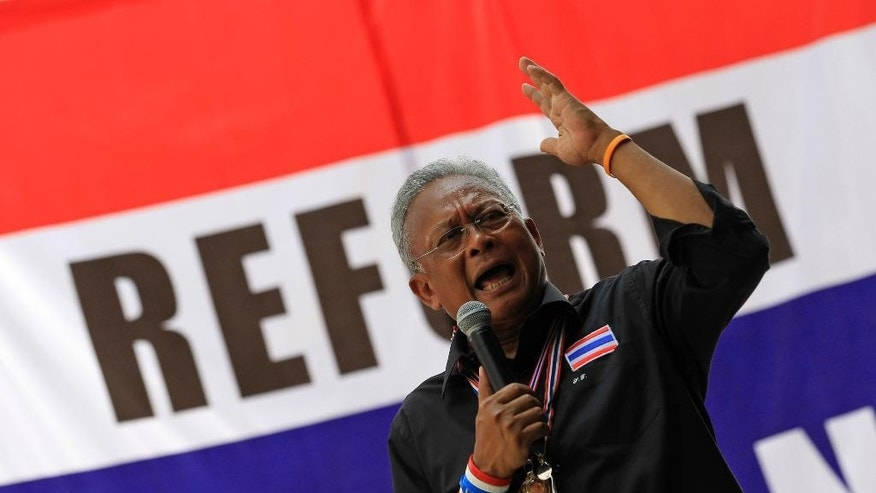 Anti-government protest leader Suthep Thaugsuban speaks to supporters in Bangkok, Thailand, Friday, Feb. 28, 2014. The leader of Thailand's anti-government protest movement said Thursday he is willing to negotiate to end the country's political crisis, if Prime Minister Yingluck Shinawatra is willing to talk with him live, one-to-one, on every national television station. (AP Photo/Sakchai Lalit)