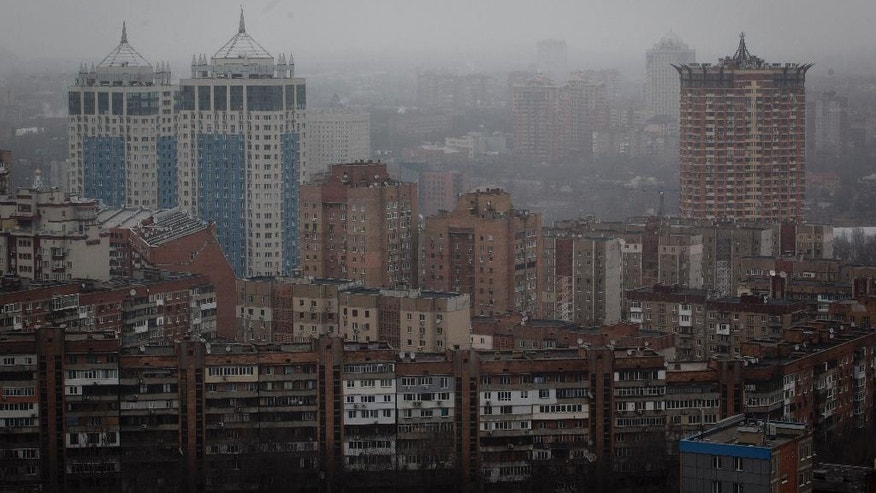 In this photo taken Wednesday, Feb. 26, 2014, Soviet-era apartments blocks are seen from a skyscraper in Donetsk, eastern Ukraine. If Ukraine looks neatly delineated on maps, its history is a tangle of invasions and occupations and peoples and religions, a place of ill-defined borders that for centuries has been struggling to define itself. The modern nation is so sharply divided by culture and loyalty, split between allegiance to Moscow and allegiance to Western Europe, that it often can appear ready to simply snap in two. (AP Photo/Darko Bandic)