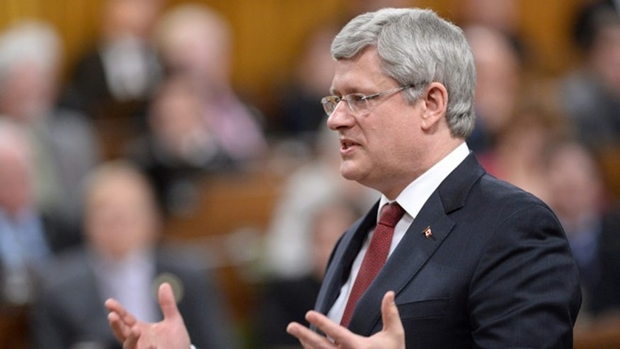 Feb. 26, 2014: Prime Minister Stephen Harper responds to a question during question period in the House of Commons on Parliament Hill in Ottawa.