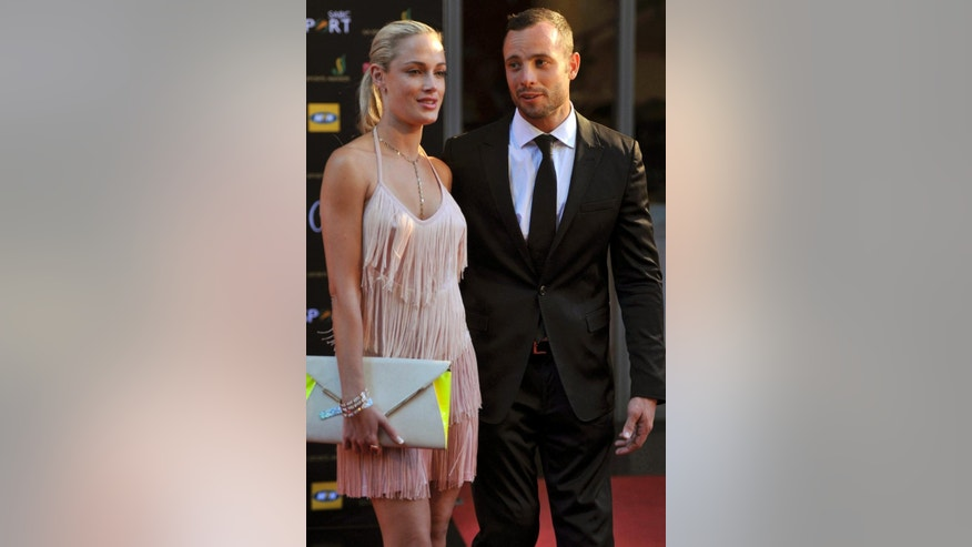 FILE  This Nov. 4, 2012 photo shows Oscar Pistorius and girlfriend Reeva Steenkamp at an awards ceremony in Johannesburg, South Africa.  Pistorius goes on trial Monday March 3, for the shooting death of Steenkamp. (AP Photo/City Press, Lucky Nxumalo) SOUTH AFRICA OUT
