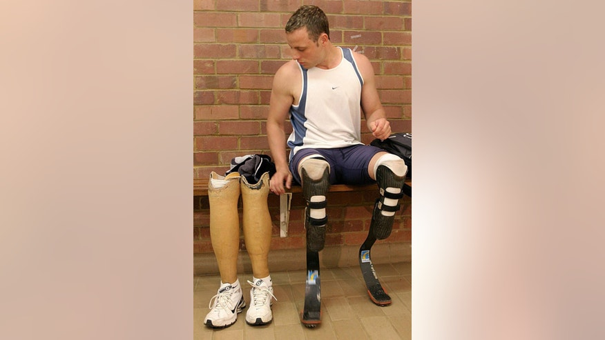 FILE : in this Thursday, June 21, 2007 file photo  South African amputee champion sprinter, Oscar Pistorius, prior to a training session in Pretoria, South Africa. Born with a congenital condition, Pistorius had his lower legs amputated before he was a year old yet grew up to be an unlikely track athlete, an Olympic finalist and an international superstar who blurred the lines between able-bodied and disabled. Pistorius goes on trial Monday March 3, 2014 for the shooting death of his girlfriend Reeva Steenkamp. (AP Photo/Denis Farrell, File)